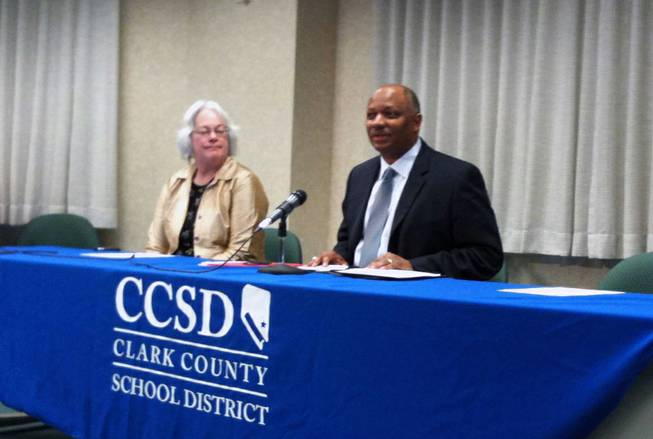 Superintendent Dwight Jones speaks with the media with School Board President Carolyn Edwards about the district's School Improvement Grant application.