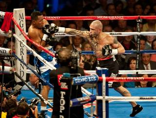 Miguel Cotto defeats Ricardo Mayorga at MGM Grand Garden Arena on March 12, 2011. Tom Zbikowski of the Baltimore Ravens also won his bout.