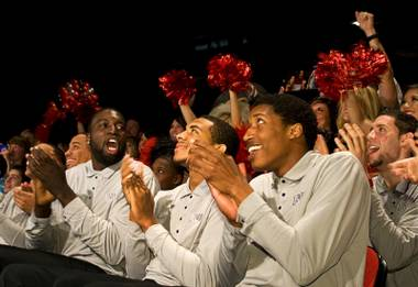 Members of the UNLV men's basketball team celebrate as their name is announced in a NCAA tournament selection show being shown at the Cox Pavilion at UNLV on Sunday, March 13, 2011. The Rebels will play Illinois on Friday in Tulsa, Okla.