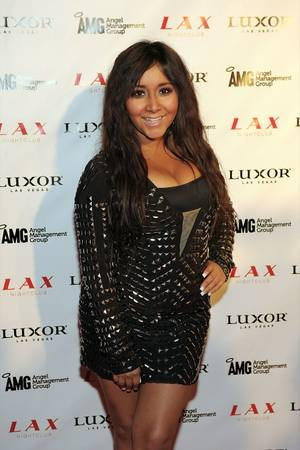 "Nicole ""Snooki"" Polizzi kicks off spring break at LAX on March 12, 2011."