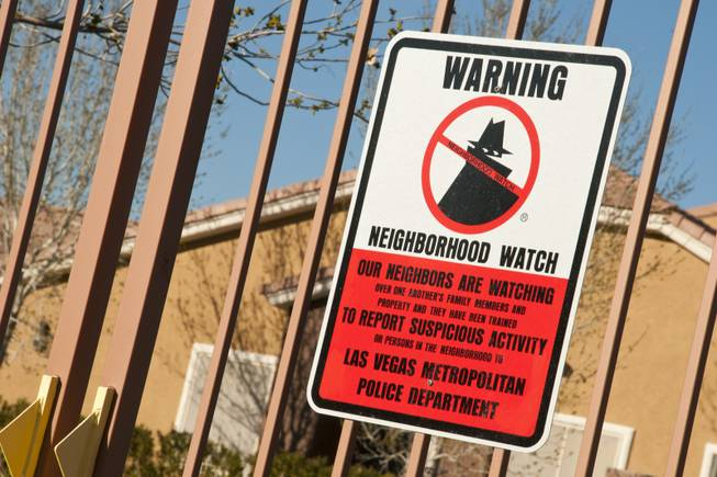 A Neighborhood Watch sign is posted at the entrance to a gated community to show their concern in keeping a safe neighborhood, Tues March 15th, 2011