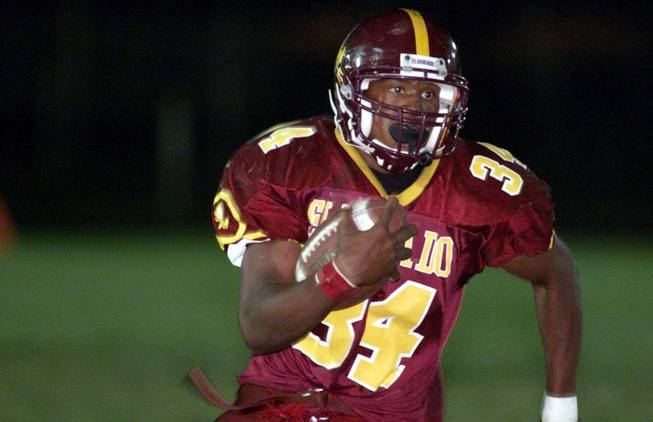Former Eldorado High running back Steven Jackson runs for yardage in a game against Bishop Gorman on Friday, Sept. 8, 2000. Jackson, a seven-year professional with the St. Louis Rams, will be inducted into the Southern Nevada Sports Hall of Fame in June.