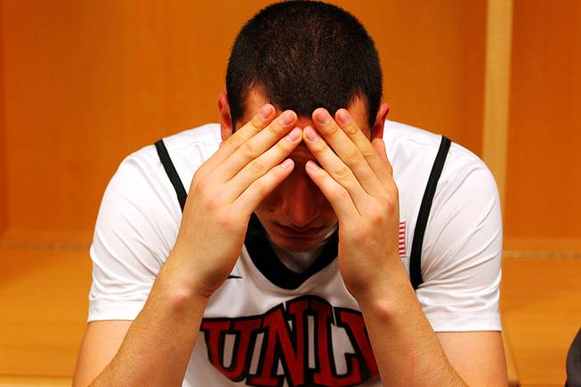 UNLV guard Karam Mashour rests his head in his hands after losing to Illinois 73-62 in the second round of the NCAA basketball championships on Friday, March 18, 2011, at the BOK Center in Tulsa.