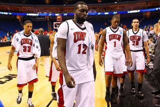 UNLV players, from left, Tre'Von Willis, Brice Massamba, Quintrell Thomas and Karam Mashour leave the court after their game against Illinois in the second round of the NCAA basketball championships Friday, March 18, 2011, at the BOK Center in Tulsa. Illinois won the game 73-62.