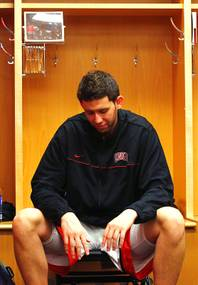 UNLV forward Carlos Lopez sits in the locker room after their 73-62 loss to Illinois in the second round of the NCAA basketball championships Friday, March 18, 2011, at the BOK Center in Tulsa.