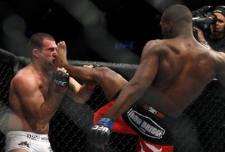 Jon Jones, right, kicks  Mauricio Rua  during their mixed martial arts match at UFC 128  Saturday, March 19, 2011, in Newark, N.J. Jones won by TKO.