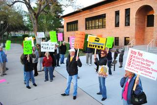 Protesters gather in front of Boulder City Hall on Tuesday to demonstrate against the city's decision to sue the petitioners of two ballot questions that passed in November.