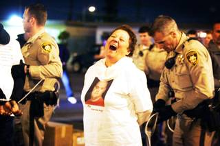A woman is taken into custody by Metro Police after a nonviolent sit-in on Teddy Drive outside of Palace Station following a march by Culinary Union Local 226 members from their headquarters to Palace Station as a statement against Station Casinos' treatment of Latino workers on Thursday, March 24, 2011.