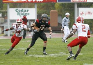 Coronado High graduate Tysson Poots looks for yardage after a catch during his college career at Southern Utah. Poots is preparing for the April NFL Draft.