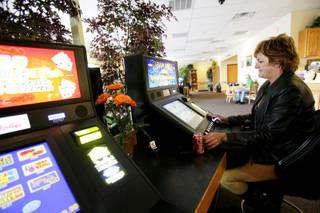 Cindy Clark plays a slot machine at Dotty's near Eastern and Serene in Henderson on Thursday, March 24, 2011.
