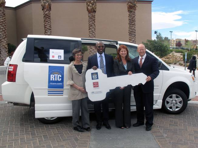 The Regional Transportation Commission hands off a ceremonial key to Easter Seals and ITNLasVegasValley, which will provide paratransit service for parts of Henderson. From left: ITN co-director Fran Smith, Easter Seals Board Chair Karl Armstrong, Henderson City Councilwoman Debra March and RTC General Manager Jacob Snow.