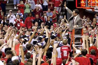 UNLV coach Lon Kruger waves to fans after cutting down the net following UNLV's 78-70 win over BYU in the Mountain West Conference championship game Saturday, March 10, 2007.