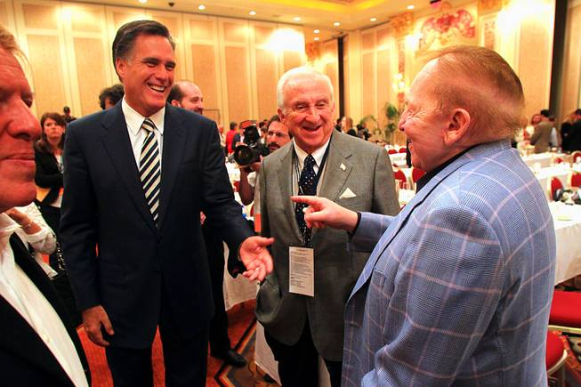 Former Massachusetts Gov. Mitt Romney talks to Sheldon Adelson after addressing a meeting of the Republican Jewish Coalition, April 2, 2011.