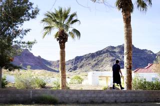 Enrique, 14, takes a walk outside on the campus of  St. Jude's Ranch for Children in Boulder City Monday, April 4, 2011.