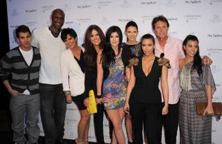 Rob Kardashian, Lamar Odom, Kris Jenner, Khloe Kardashian, Kylie Jenner, Kendall Jenner, Kim Kardashian, Bruce Jenner and Kourtney Kardashian attend the Khloe Kardashian Odom And Lamar Odom Fragrance Launch For