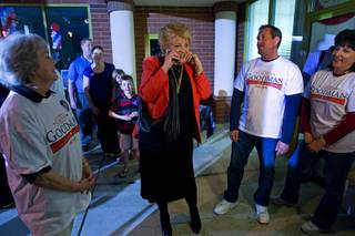 Carolyn Goodman takes a call from a supporter at her campaign headquarters Tuesday, April 5, 2011.