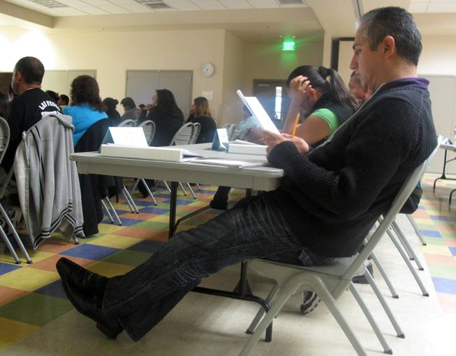 A student reads his notes during a Hispanic Citizens Academy class at the Pearson Community Center. At this Hispanic Citizens Academy, the eighth so far of the program's history, North Las Vegas Police are training under Metro Police officers to expand the program in their jurisdiction.