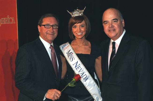 LVCVA president Rossi Ralenkotter and Planet Hollywood Worldwide president Bill Feather flank Miss Nevada 2010 Christina Keegan.