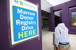 A volunteer enters the Dr. William U. Pearson Community Center in Las Vegas during the bone marrow registration drive was held Saturday, April 9, 2011. The drive was for  Las Vegan Jeffery Watkins and other African-Americans in need of bone marrow transplants.
