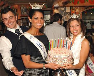 Miss Pennsylvania Shannon Doyle and Miss Delaware Heather Lehman are presented with a special birthday cake at Buca di Beppo on Jan. 23, 2010.