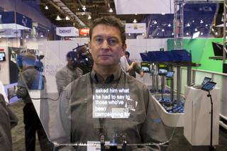 Brian Larter, managing director of Autoscript, poses behind a Autoscript Executive systems prompter during the National Association of Broadcasters (NAB) Show at the Las Vegas Convention Center Tuesday, April 12, 2011. Over 92,000 people registered for the 2011 NAB Show which runs through Thursday. The 2010 NAB Show attendance was 88,044.