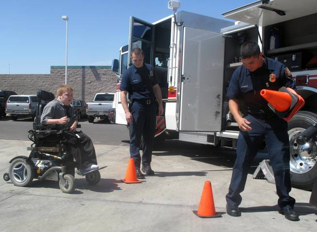 Henderson firefighters set up an obstacle course for 11-year-old Kyle Preston, who has Duchenne muscular dystrophy. Kyle and his brother, Ian, attended the kickoff of the 52nd annual Fill-the-Boot campaign, which benefits the Muscular Dystrophy Association.