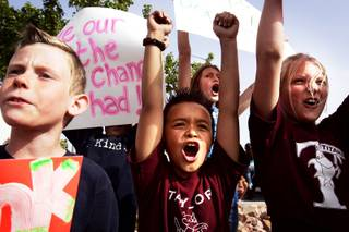 Andrew Piotrowski, 9, from left, Lincoln Aquino, 9, and Alexis Almeido, 11, all students at Glen Taylor Elementary School, rally to encourage the governor and Legislature to support education at Glen Taylor Elementary School in Henderson Wednesday, April 13, 2011.