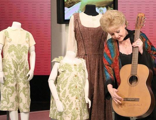 Debbie Reynolds with costumes and props from <em>The Sound of Music</em>.