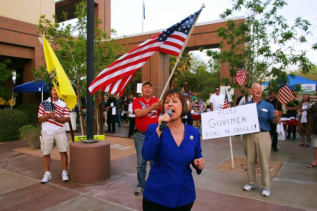 "Sharron Angle belts out Lee Greenwood's ""God Bless the U.S.A."" during a tax day Tea Party rally sponsored by Tea Party & Republicans Uniting Nevada Conservatives and Americans for Prosperity Friday, April 15, 2011, at the Grant Sawyer Building."