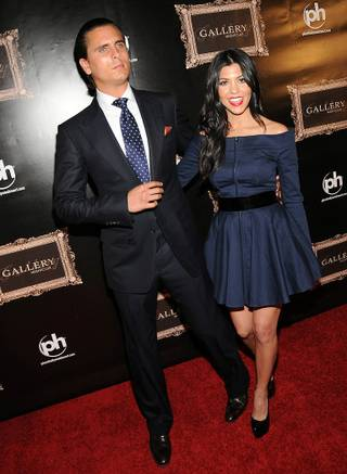 Scott Disick and Kourtney Kardashian arrive at the grand opening of Gallery Nightclub at Planet Hollywood on April 15, 2011.