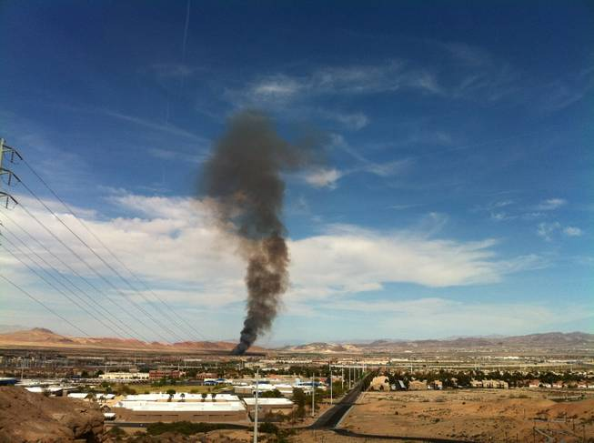Smoke from a brush fire near Sam Boyd Stadium could be seen across the valley Saturday afternoon.