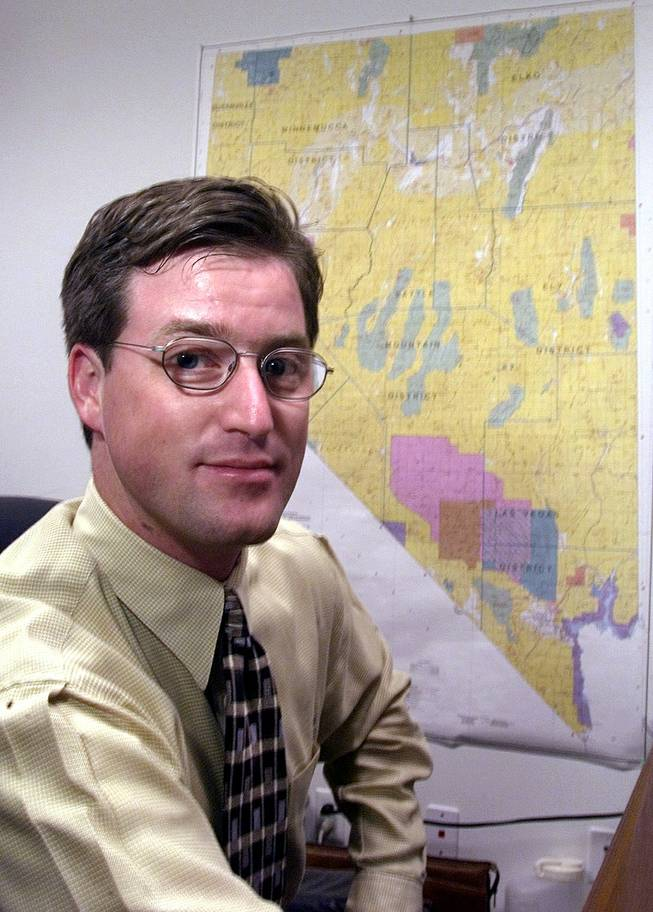 Nevada Mining Association representative Tim Crowley sits in front of a state map Tuesday, February 15, 2000, in the association's Las Vegas office.