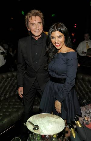 Barry Manilow and Kourtney Kardashian at the grand opening of Gallery Nightclub at Planet Hollywood on April 15, 2011.