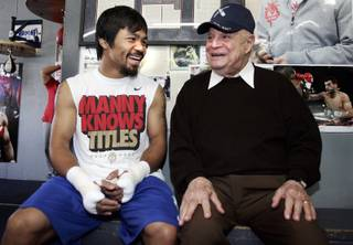 Filipino boxer Manny Pacquiao shares a laugh with comedian Don Rickles during a workout at the Wildcard Boxing Club in Hollywood Thursday, April 21, 2011. Pacquiao is preparing for his upcoming welterweight fight against