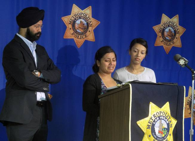 Amandeep Kaur, center, pleads for people to come forward with information about the murder of her husband, Amanpreet Singh. The business owner and father of two young boys was shot to death March 30  outside a Wells Fargo Bank near Sunset Road and Eastern Avenue. His family donated $5,000 to Crime Stoppers on Tuesday in hopes of generating more tips.
