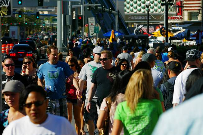 Tourists walk along the Las Vegas Strip in this April 28, 2011, file photo.