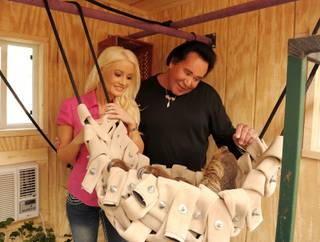 Wayne Newton gives Holly Madison two sloths at his Wayne Newton's Shenandoah on May 9, 2011.