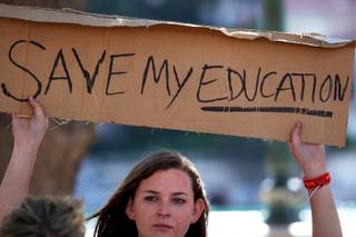 Jaynie Connor holds a sign in front of the Bellagio as Clark County high school students rally Friday, April 29, 2011, in protest of cuts to the education budget.