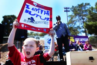 Alec Miller, 6, cheers as Nevada Senate Majority Leader Steven Horsford, D-North Las Vegas, addresses the hundreds gathered Saturday, April 30, 2011, at Cashman Field to protest proposed cuts to education.