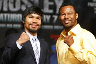 Boxers Manny Pacquiao, left, of the Philippines and Shane Mosley of Pomona, Calif. pose during a news conference at the MGM Grand Wednesday, May 4, 2011. Pacquiao will defend his WBO welterweight title against Mosley at the MGM Grand Garden Arena on Saturday.