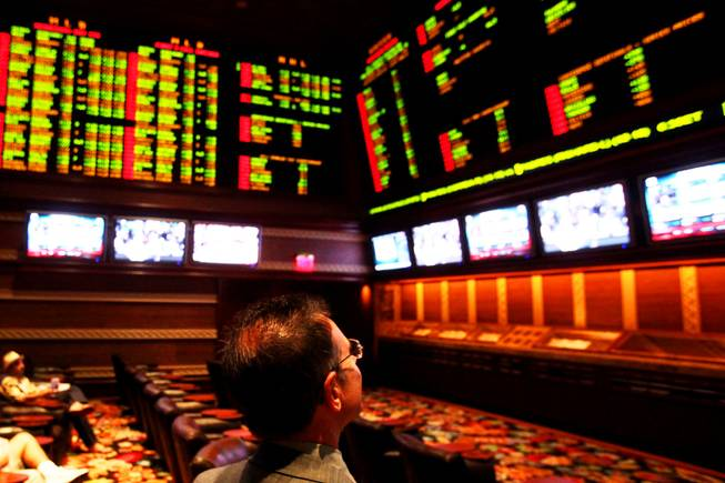 Race and sports book director Johnny Avello checks the screens at the sports book at Wynn Las Vegas on Wednesday, May 4, 2011.