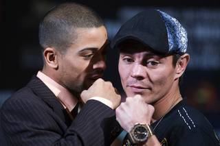 Super bantamweight boxer Wilfredo Vazquez Jr., left, of Puerto Rico speaks to Jorge Arce of Mexico as they pose during a news conference at the MGM Grand Thursday, May 5, 2011. Vazquez will defend his WBO super bantamweight title against Arce at the MGM Grand Garden Arena on Saturday.