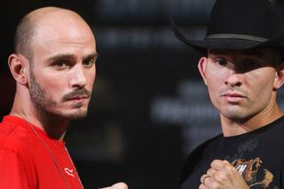 Former middleweight champion Kelly Pavlik, left, of Youngstown, Ohio and Alfonso Lopez of Cut and Shoot, Texas, pose during a news conference at the MGM Grand Thursday, May 5, 2011. Pavlik is attempting a comeback after checking into rehab for alcohol issues last year. The boxers are scheduled for a 10-round super middleweight undercard bout at the MGM Grand Garden Arena Saturday.