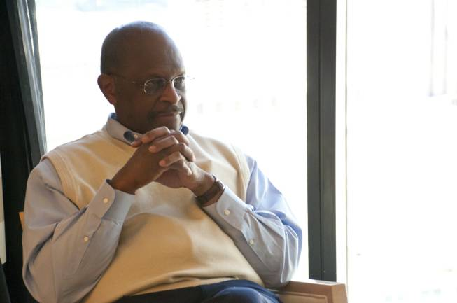 Herman Cain, GOP presidential nominee, sits down with reporters during a roundtable discussion at the Encore Hotel and Casino, Fri May 6th, 2011.