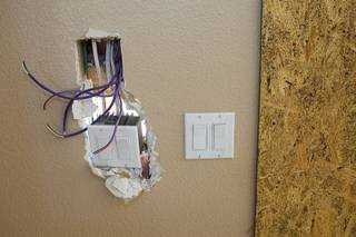 Electrical switches are shown at a foreclosure home in Summerlin Thursday, August 4, 2011. Scott and Aimie Yancey are negotiating to buy the home for their television show