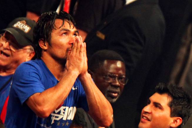Manny Pacquiao celebrates his unanimous decision win over Shane Mosely to keep the WBO world welterweight title at MGM Grand Garden Arena Saturday, May 7, 2011.