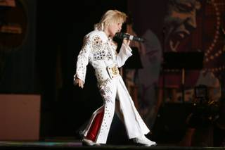 Gabriel Jarrett, a 6-year-old from Jacksonville, Fla., performs during the second annual Las Vegas Ultimate Elvis Tribute Artist Contest  Saturday, May 7, 2011 at the Fremont Street Experience.