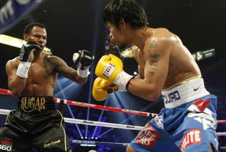 Shane Mosley fights Manny Pacquiao during their WBO welterweight title fight at the MGM Grand Garden Arena on May 7, 2011.