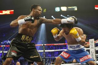 Shane Mosley punches at Manny Pacquiao during their WBO welterweight title fight at the MGM Grand Garden Arena on May 7, 2011.