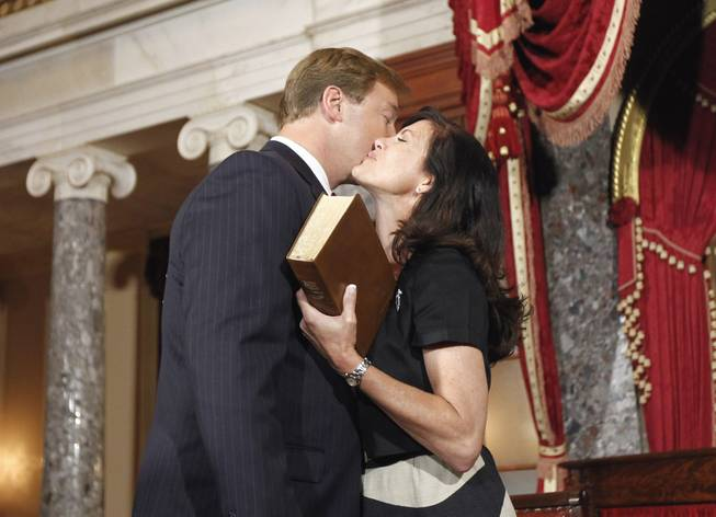 Sen. Dean Heller, kisses his wife Lynne Heller in the Old Senate Chambers on Capitol Hill in Washington, Monday, May 9, 2011, prior to his mock swearing ceremony. Heller was 50 at the time.